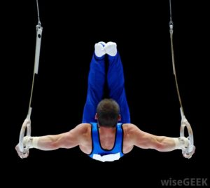 gymnast-in-blue-against-black-background